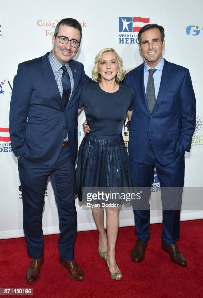John Oliver Lee Woodruff and Bob Woodruff attend the 11th Annual Stand Up for Heroes Event presented by The New York Comedy Festival and The Bob...