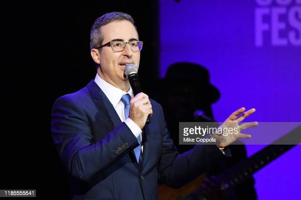 John Oliver performs onstage during the 13th annual Stand Up for Heroes to benefit the Bob Woodruff Foundation at The Hulu Theater at Madison Square...