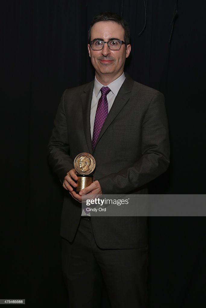 John Oliver poses with award during The 74th Annual Peabody Awards Ceremony at Cipriani Wall Street on May 31, 2015 in New York City.