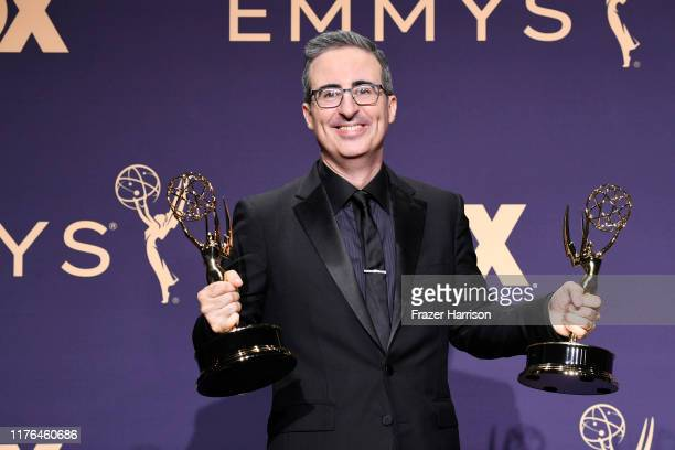 John Oliver poses with award for Outstanding Variety Talk Series in the press room during the 71st Emmy Awards at Microsoft Theater on September 22...
