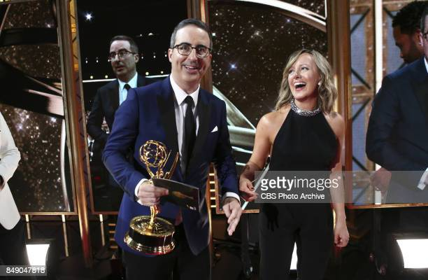John Oliver walks off the stage after winning the Emmy Award for Outstanding Variety Talk Series at the 69TH PRIMETIME EMMY AWARDS LIVE from the...
