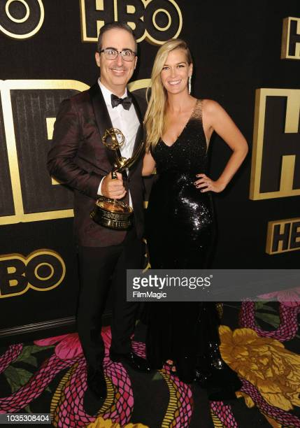"""John Oliver , winner of the award for Outstanding Writing for a Variety Series for """"Last Week Tonight with John Oliver,"""" and Kate Norley arrive at..."""