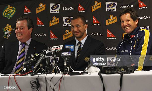 John O'Neill, Quade Cooper and Robbie Deans laugh during a press conference to announce the re-signing of Cooper to the ARU after the Australian...