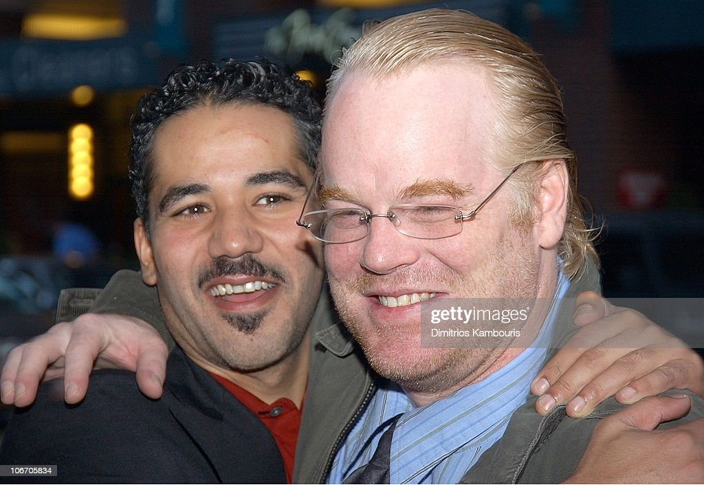 John Ortiz and Philip Seymour Hoffman during 1st Annual LAByrinth Theater Company Celebrity Charades Benefit presented by Gotham and LA Confidential Magazine at Daryl Roth Theater in New York City, New York, United States.