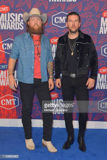 John Osborne and TJ Osborne of Brothers Osborne attend the 2019 CMT Music Awards at Bridgestone Arena on June 05 2019 in Nashville Tennessee