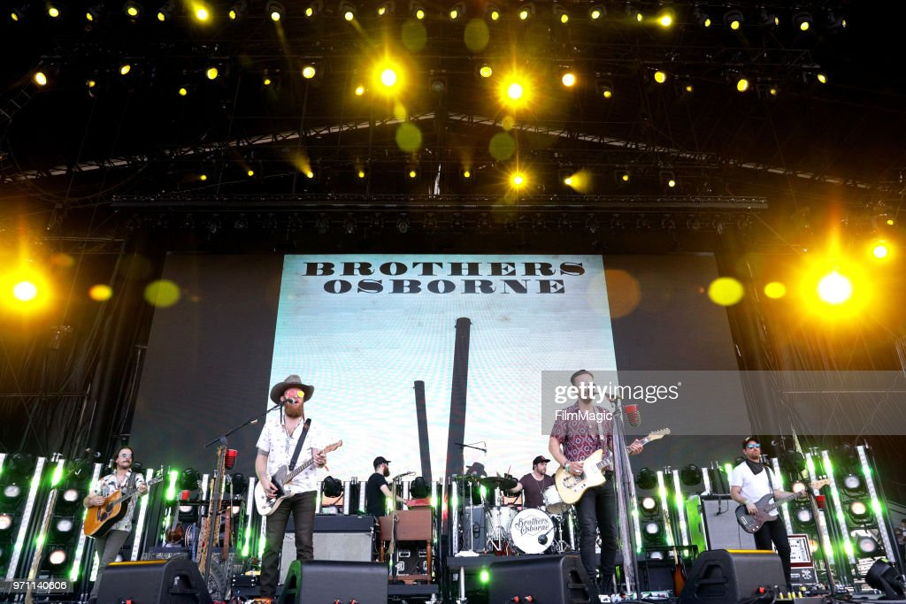 John Osborne (L) and T.J. Osborne of Brothers Osborne perform on What Stage during day 4 of the 2018 Bonnaroo Arts And Music Festival on June 10, 2018 in Manchester, Tennessee.
