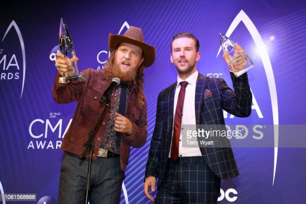 John Osborne and TJ Osborne of Brothers Osborne pose with award at the 52nd annual CMA Awards at the Bridgestone Arena on November 14 2018 in...