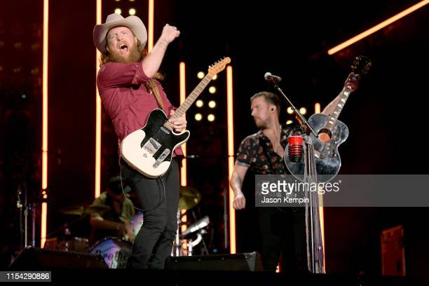 John Osborne and TJ Osborne of musical duo Brothers Osborne perform on stage during day 1 of 2019 CMA Music Festival on June 06 2019 in Nashville...