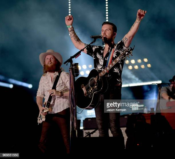 John Osborne and TJ Osborne of musical duo Brothers Osborne perform onstage during the 2018 CMA Music festival at the Nissan Stadium on June 7 2018...