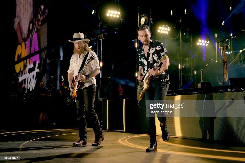 John Osborne (L) and T.J. Osborne (R) of musical duo Brothers Osborne perform onstage during the 2018 CMA Music festival at the Nissan Stadium on June 7, 2018 in Nashville, Tennessee.