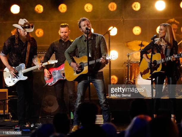 John Osborne of Brothers Osborne Dierks Bentley and Sheryl Crow perform onstage during the 53rd annual CMA Awards at the Bridgestone Arena on...