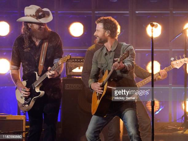 John Osborne of Brothers Osborne Dierks Bentley perform onstage during the 53rd annual CMA Awards at the Bridgestone Arena on November 13 2019 in...