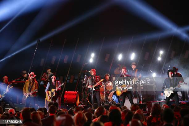 John Osborne of Brothers Osborne Kix Books and Ronnie Dunn of Brooks Dunn and TJ Osborne of Brothers Osborne perform onstage during the 53rd annual...