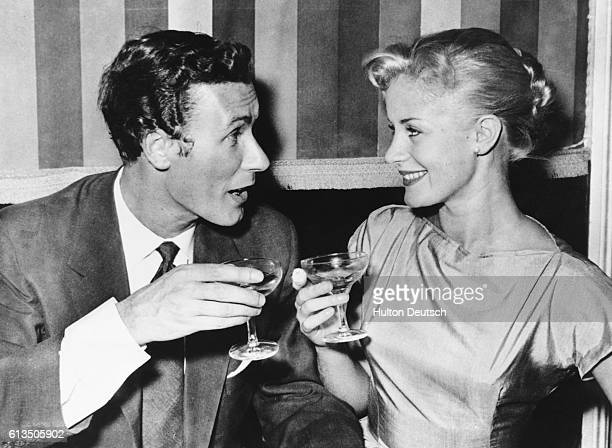 John Osborne the playwright and actor, and his bride, the actress Mary Ure, toast each other after their wedding in London, 1967. Ure plays the lead...