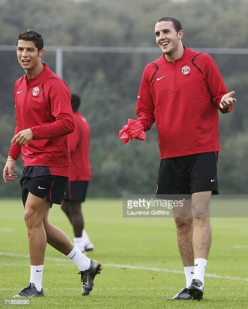 John O'Shea and Cristiano Ronaldo of Manchester United share a joke during training ahead of the Champions League match against Celtic at Carrinton...