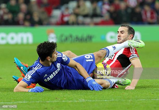 John O'Shea and Diego Costa in a full blooded challenge during the Barclays Premier League match between Sunderland AFC and Chelsea at the Stadium of...