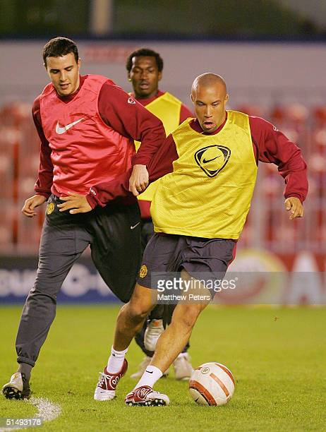 John O'Shea and Mikael Silvestre of Manchester United in action on the ball during a training session ahead of the UEFA Champions League match...