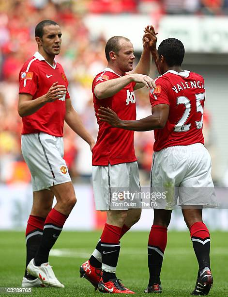John O'Shea and Wayne Rooney of Manchester United congratulate team mate Antonio Valencia on scoring the opening goal during the FA Community Shield...