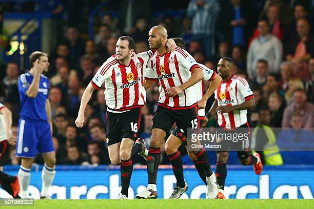 John O'Shea and Younes Kaboul of Sunderland celebrate their team's first goal during the Barclays Premier League match between Chelsea and Sunderland...