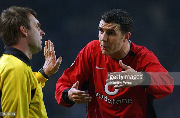 John O'Shea appeals to a referee's assistant after Roy Keane was sent off for stepping on goalkeeper Vitor Baia during the UEFA Champions League...