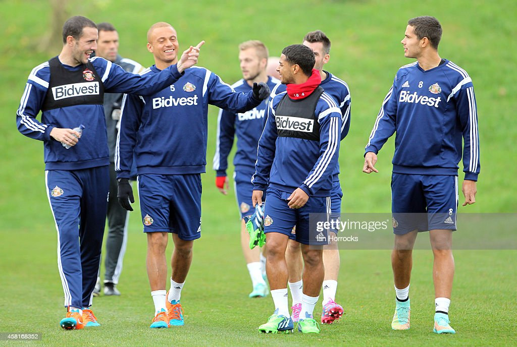 John O'Shea (L) leads the conversation during a Sunderland AFC Training Session at The Academy of Light on October 31, 2014 in Sunderland, England.