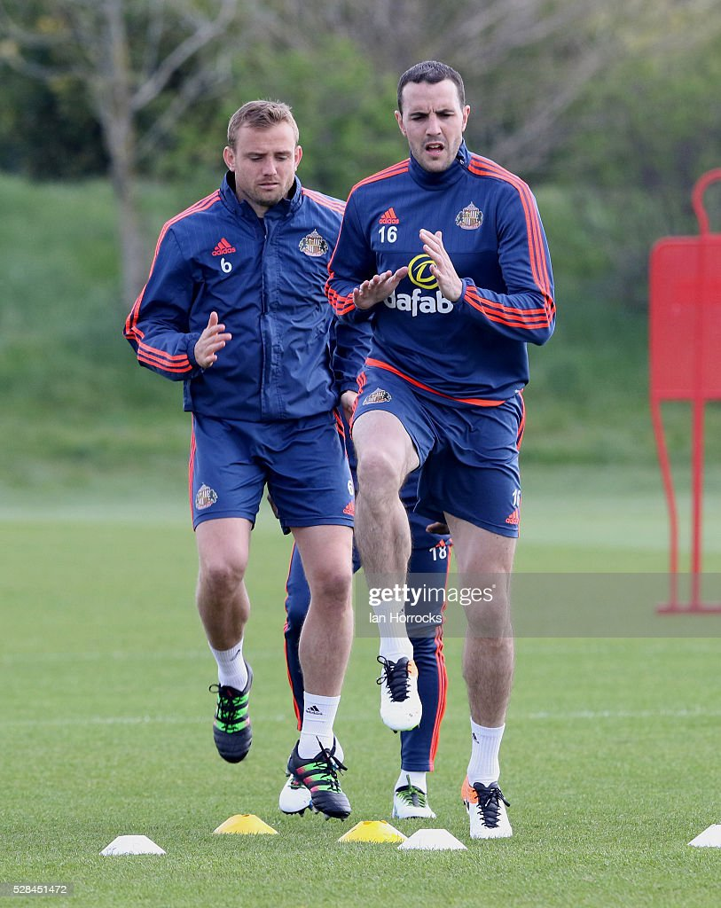 John O.Shea leads the way with Lee Cattermole following on during a Sunderland training session at The Academy of Light on May 5, 2016 in Sunderland, England.