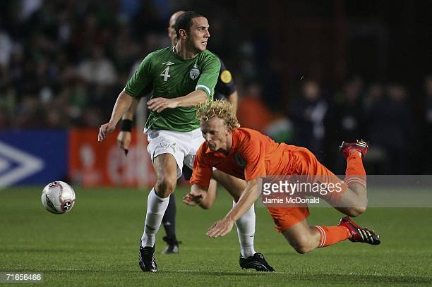 John O'Shea of Ireland tackles Dirk Kuyt of Holland during the International friendly match between the Republic of Ireland and the Netherlands at...