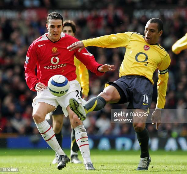 John O'Shea of Manchester United and Gilberto of Arsenal battle for the ball during the Barclays Premiership match between Manchester United and...