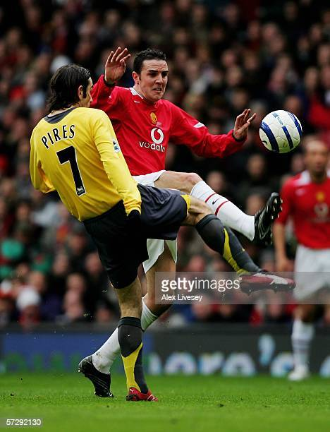 John O'Shea of Manchester United and Robert Pires of Arsenal battle for the ball during the Barclays Premiership match between Manchester United and...