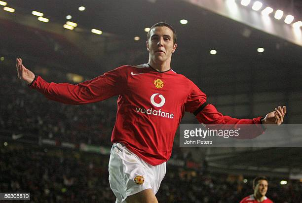 John O'Shea of Manchester United celebrates scoring the third goal during the Carling Cup match between Manchester United and West Bromwich Albion at...