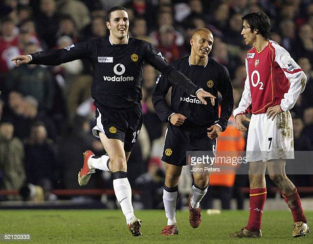 John O'Shea of Manchester United celebrates scoring their fourth goal during the Barclays Premiership match between Arsenal and Manchester United at...