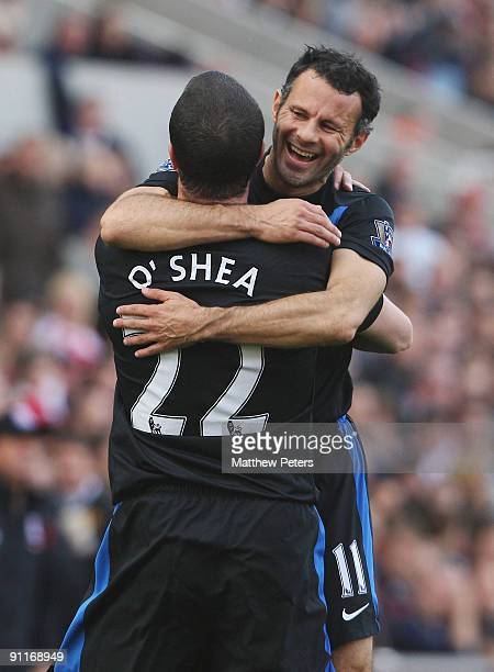 John O'Shea of Manchester United celebrates scoring their second goal during the Barclays FA Premier League match between Stoke CIty and Manchester...