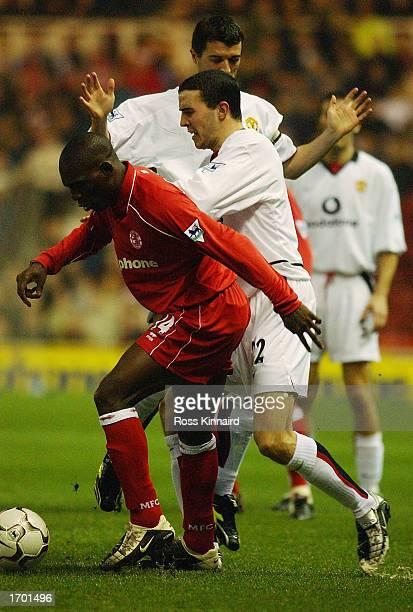 John O'Shea of Manchester United challenges Geremi of Middlesbrough during the FA Barclaycard Premiership match between Middlesbrough and Manchester...