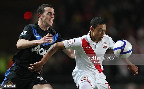 John O'Shea of Manchester United clashes with Alex Oxlade-Chamberlain of Southampton during the FA Cup sponsored by E.ON 4th round match between...