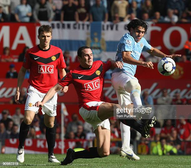John O'Shea of Manchester United clashes with Carlos Tevez and Joleon Lescott of Manchester City during the Barclays Premier League match between...