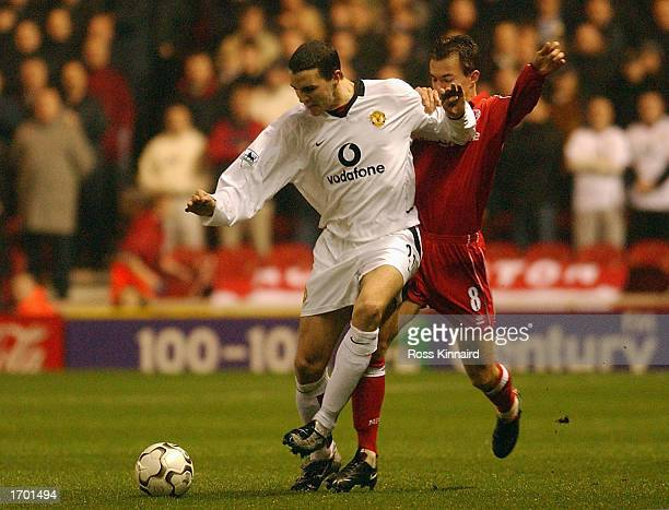 John O'Shea of Manchester United holds off Szilard Nemeth of Middlesbrough during the FA Barclaycard Premiership match between Middlesbrough and...