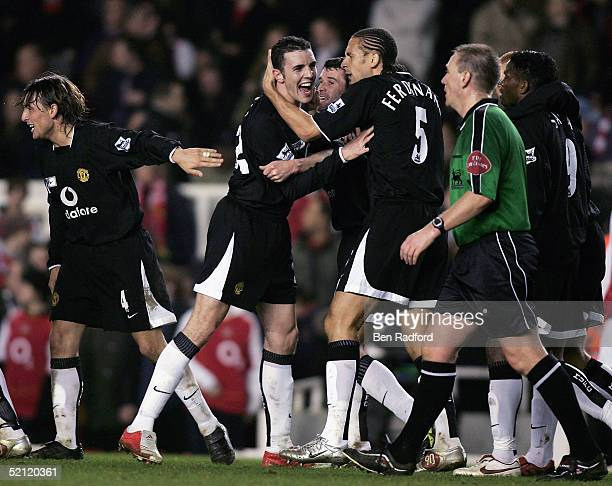 John O'Shea of Manchester United is congratulated by team mates after scoring the fourth goal for United during the Barclays Premiership match...