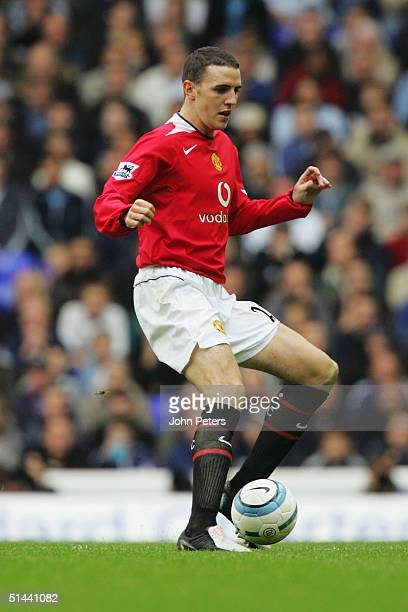 John O'Shea of Manchester United runs with the ball during the Barclays Premiership match between Tottenham Hotspur and Manchester United at Whiet...