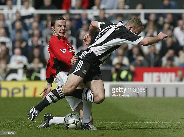John O'Shea of Manchester United tackles Alan Shearer of Newcastle United during FA Barclaycard Premiership match between Newcastle United and...
