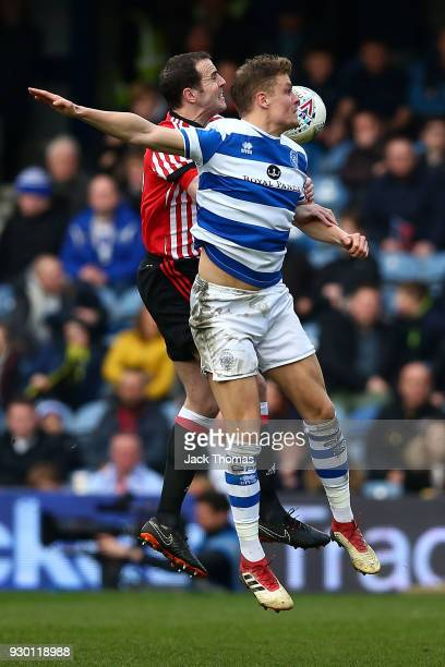 John O'Shea of Sunderland and Matt Smith of QPR in action during the Sky Bet Championship match between QPR and Sunderland at Loftus Road on March 10...