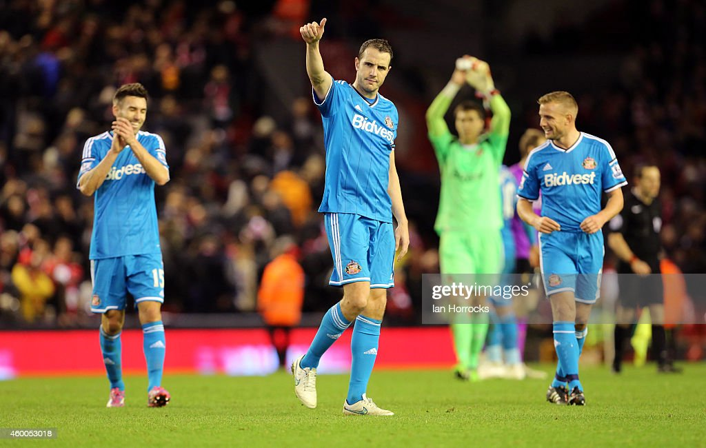 John O'Shea of Sunderland applauds the fans during the Barclays Premier League match between Liverpool and Sunderland at Anfield Stadium on December 06, 2014 in Liverpool, England.
