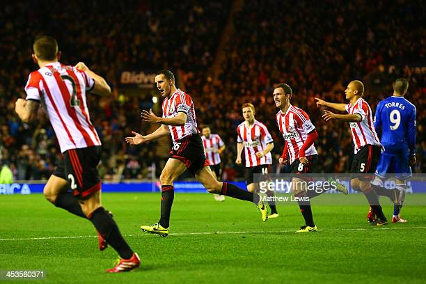 John O'Shea of Sunderland celebrates scoring his goal during the Barclays Premier League match between Sunderland and Chelsea at Stadium of Light on...