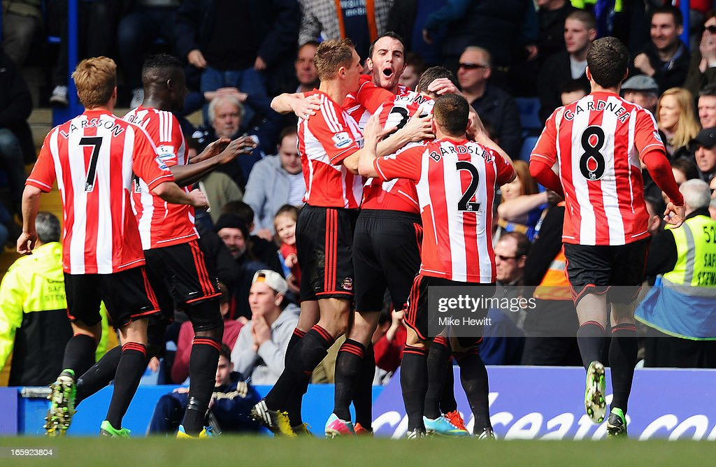 John O'Shea of Sunderland celebrates the own goal scored by Cesar Azpilicueta of Chelsea with team mates during the Barclays Premier League match between Chelsea and Sunderland at Stamford Bridge on April 7, 2013 in London, England.