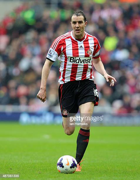 John O'Shea of Sunderland during the Barclays Premier League match between Sunderland and Cardiff City at The Stadium of Light on April 27 2014 in...
