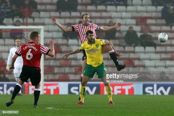 John O'Shea of Sunderland gets above Nelson Oliveira of Norwich during the Sky Bet Championship match between Sunderland and Norwich City at Stadium...