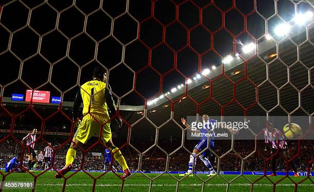 John O'Shea of Sunderland scores his goal past goalkeeper Petr Cech of Chelsea during the Barclays Premier League match between Sunderland and...