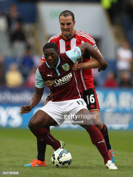 John O'Shea of Sunderland tangles with Marvin Sordell of Burnley during the Barclays Premier League match between Burnley and Sunderland at Turf Moor...