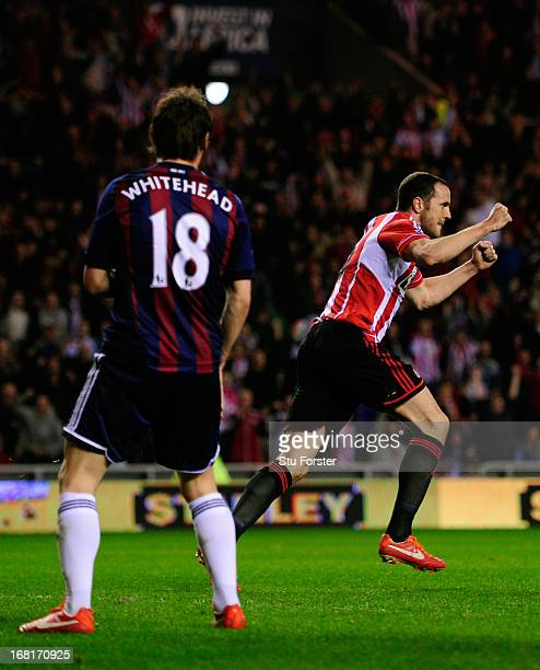 John O'Shea of Sunderland turns to celebrate after scoring the equalising goal during the Barclays Premier League match between Sunderland and Stoke...