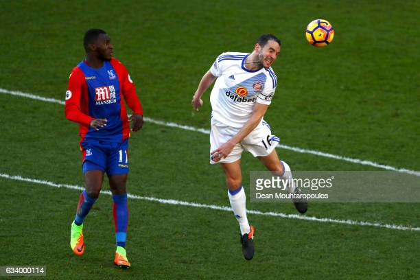 John O'Shea of Sunderland wins a header with Christian Benteke of Crystal Palace during the Premier League match between Crystal Palace and...
