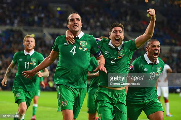 John O'Shea of the Republic of Ireland celebrates scoring the stoppage time equaliser with Stephen Ward and Jon Walters of the Republic of Ireland...